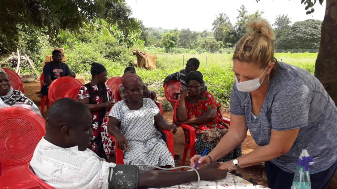 A Projects Abroad volunteer performs health checks on locals in Ghana